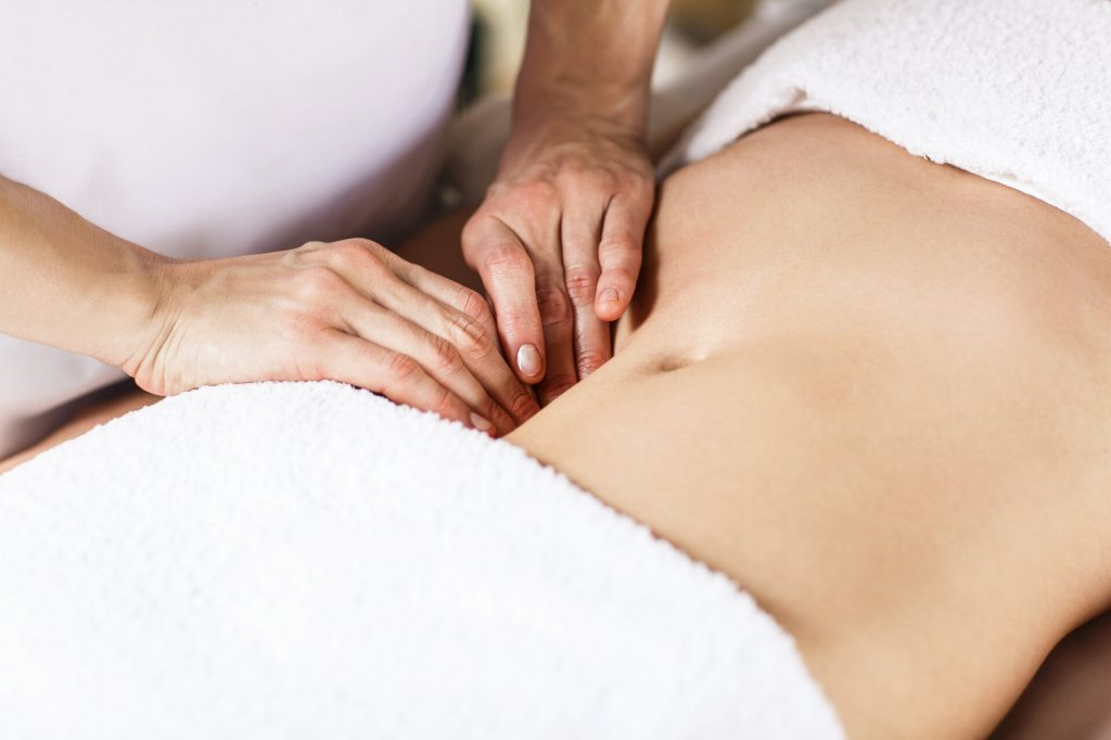 Lady receiving abdominal massage