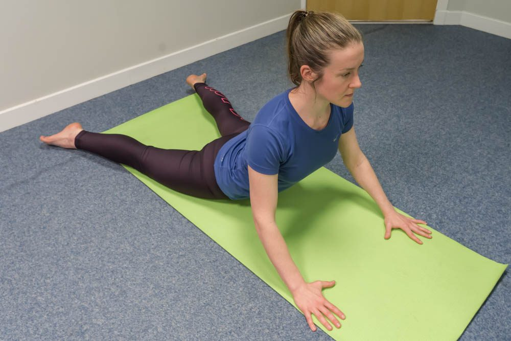 Osteopath Linda demonstrating the cobra pose