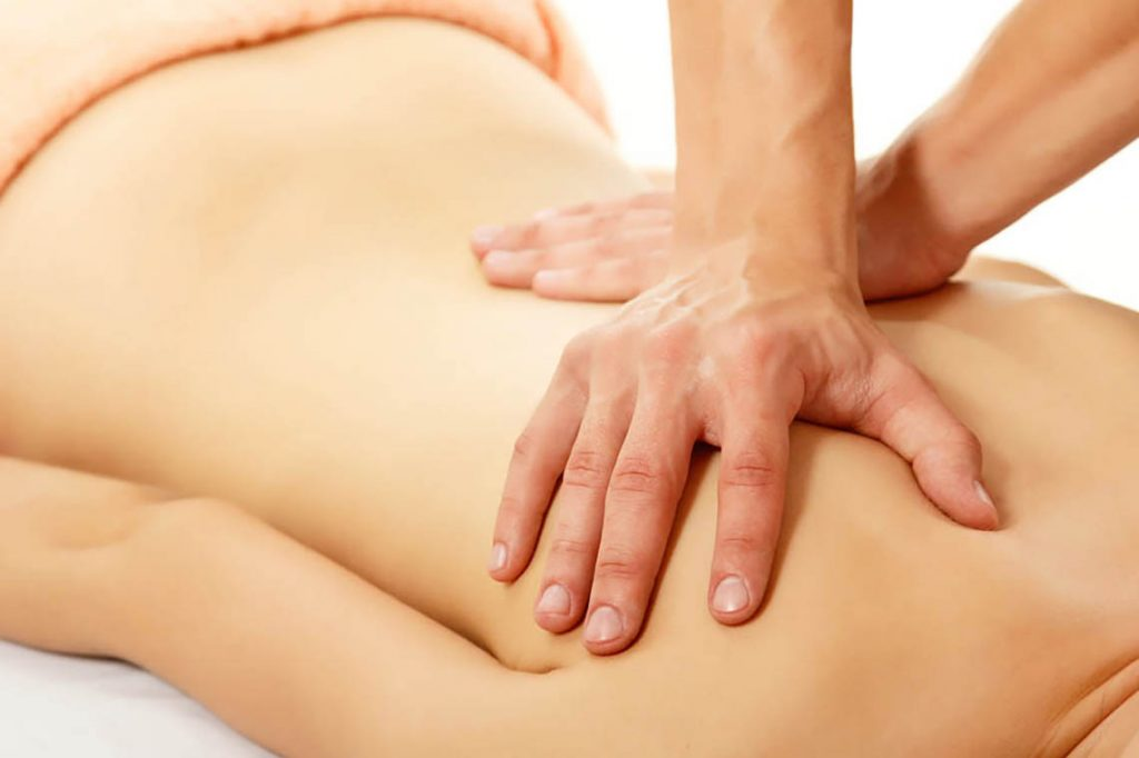 Image of lady getting her back massaged