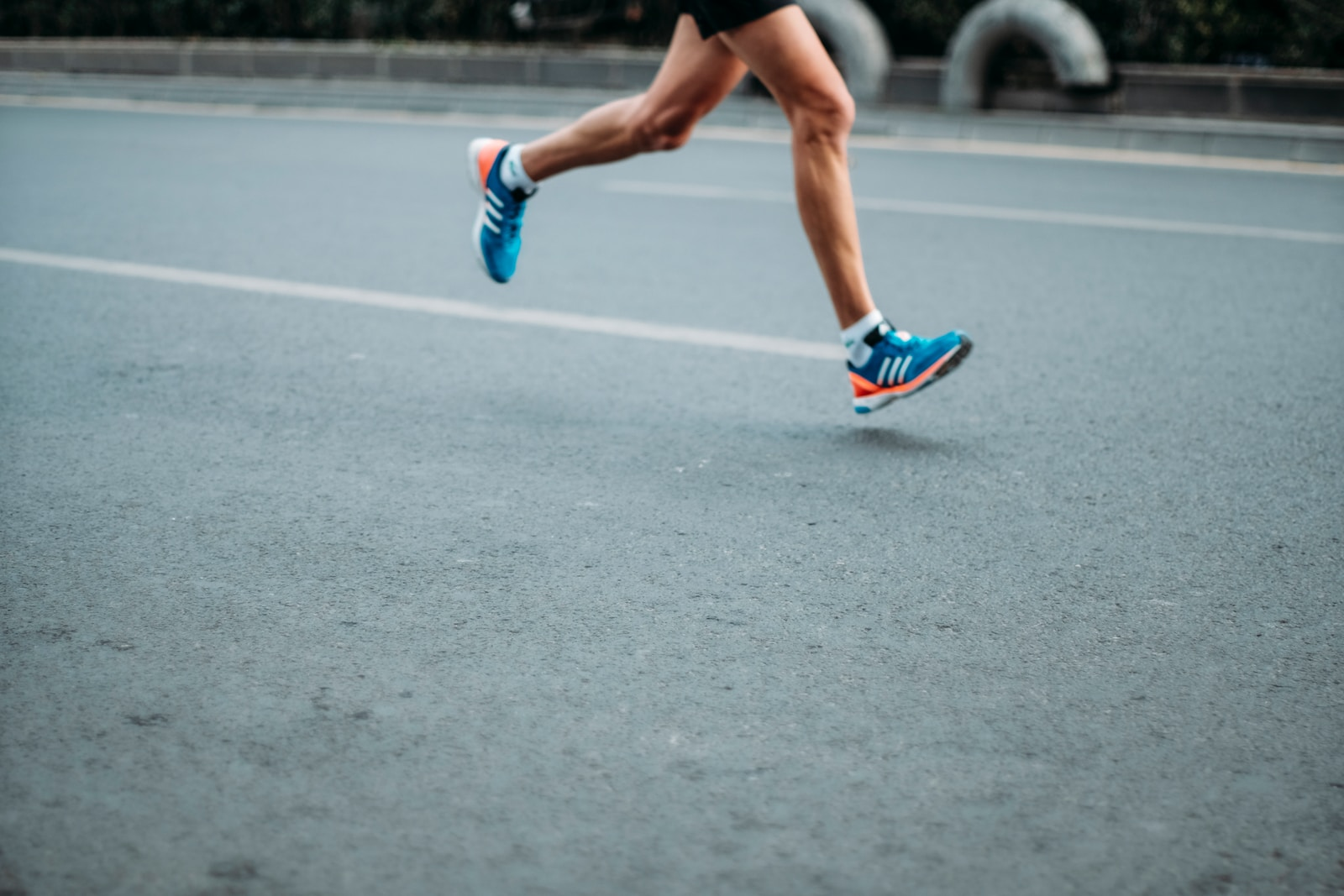 image of male legs running on a road